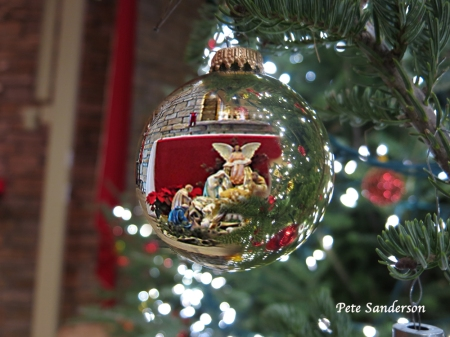 Reflection of the Manger Scene in a Christmas Tree Ornament at St. Bronislava Church