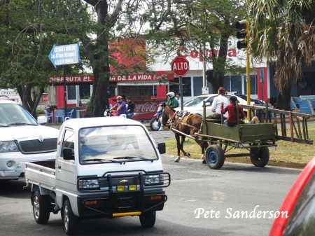 Horse powered transportation is a common sight around Nicaragua.  Here old and new delivery vehicles  pass each other on a Managua street.