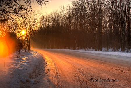West River Drive showing the golden glow of sunrise. Stevens Point, Wisconsin